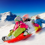 Winter, snow, family sledding at winter time